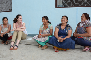 Mary also visited co-ops in Nepal after her trip to India. Here, she's seen chatting with Nepalese artisans.