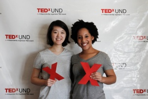 Edith Cho (left) and Deandra Cadet (right) presenting at TEDxUND on their experience with Show Some Skin and the importance of centering your narrative.